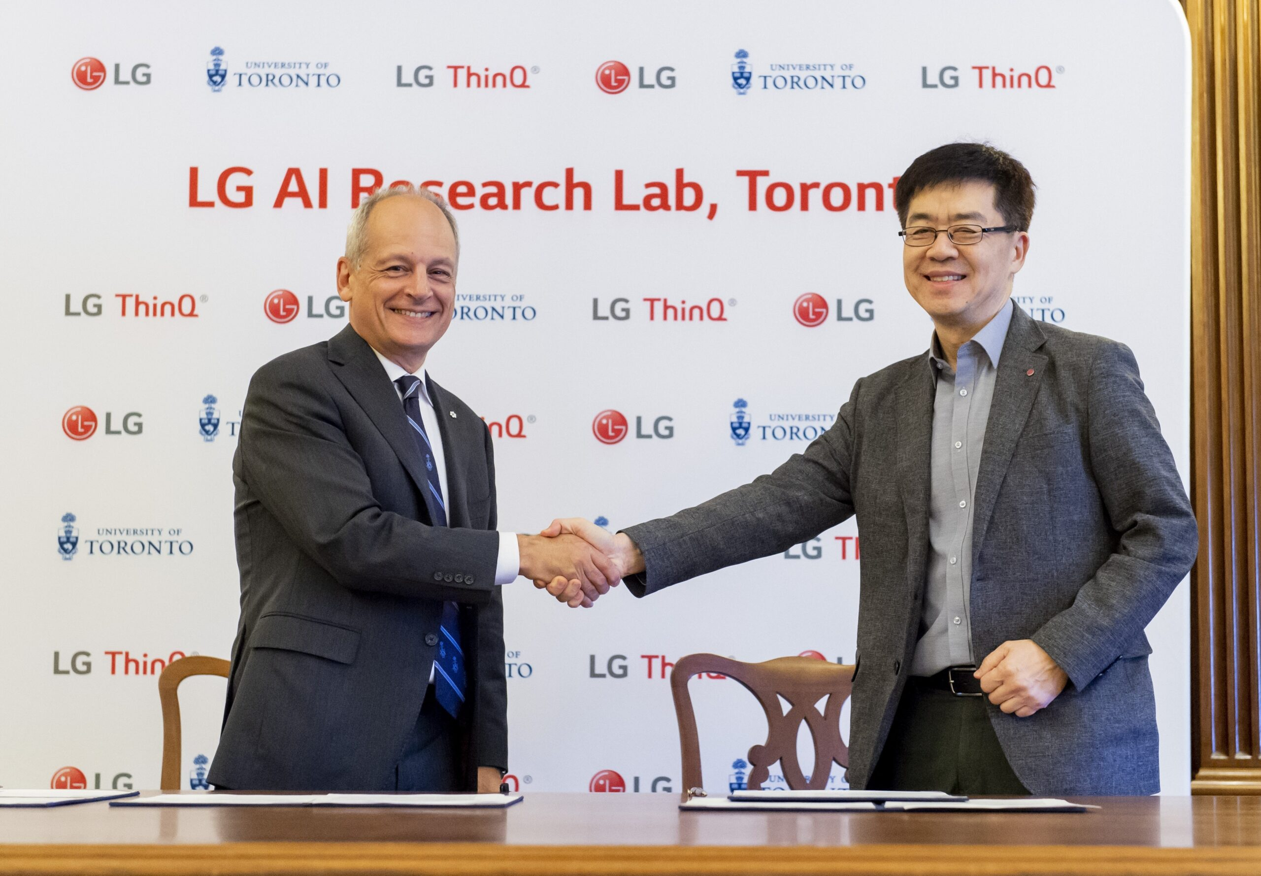 LG Electronics' president and chief technology officer, Dr. I.P. Park, shake hands with University of Toronto president, Meric Gertler.