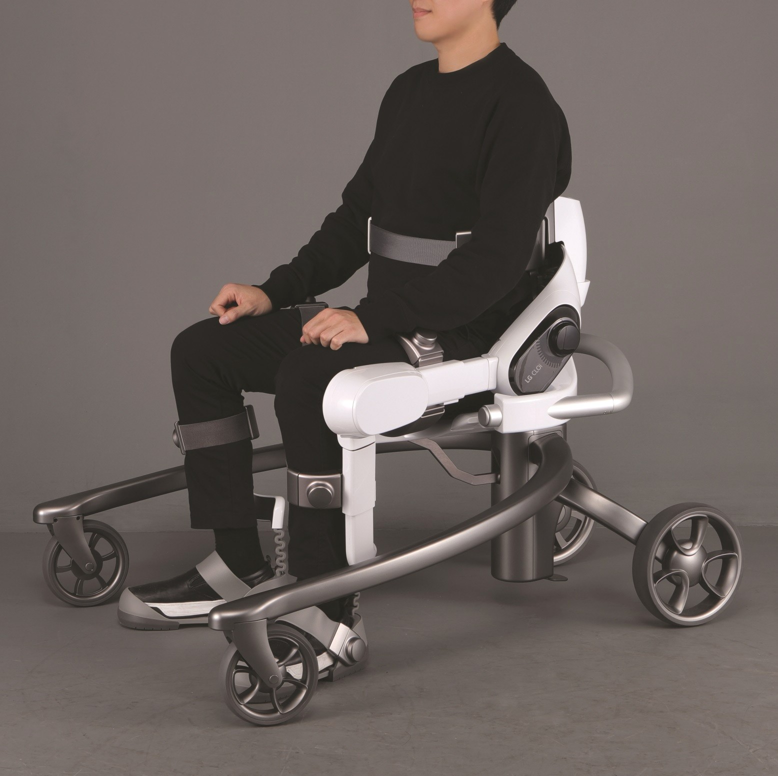 Side view of man seated on LG CLOi SuitBot