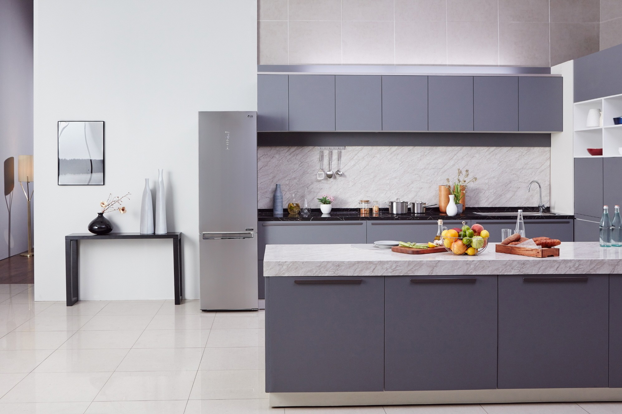 Kitchen with LG Centum System™ bottom-freezer refrigerator in the background