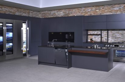 A kitchen consisting of SIGNATURE KITCHEN SUITE collection in black backdrop with brick walls