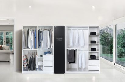 LG Styler with two doorless closests full of clothes on either side in a large living room