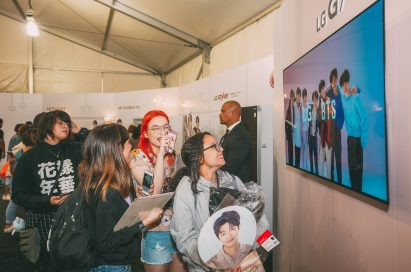 BTS fans enjoy a BTS video at the BTS Studio Presented by LG.