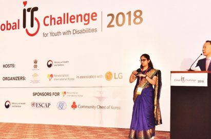 Two presenters announce the start of the 8th Global IT Challenge for Youth with Disabilities on stage, which was sponsored by LG