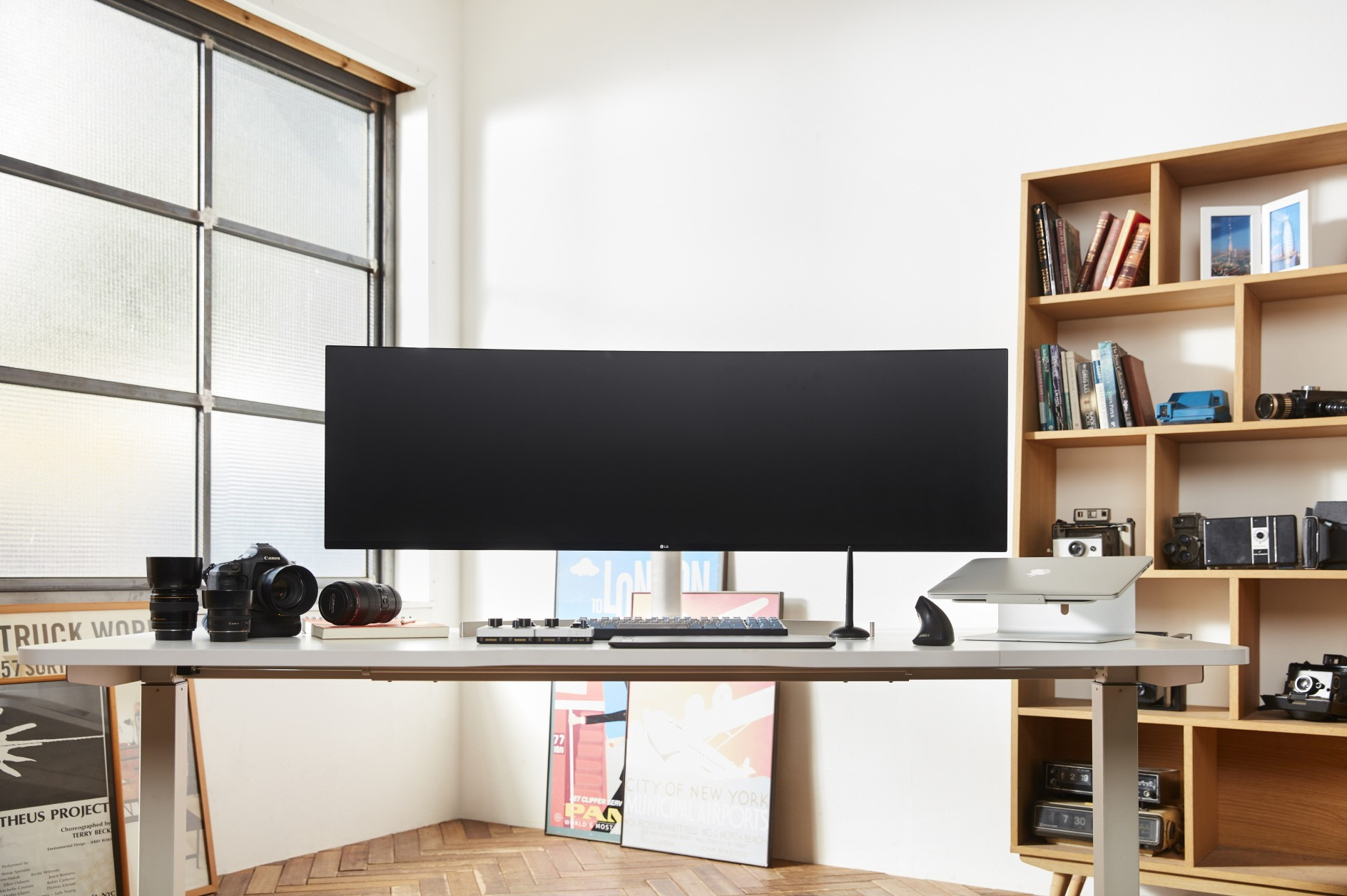 A front view of LG UltraWide monitor model 49WL95 sitting on a desk in someone's home office
