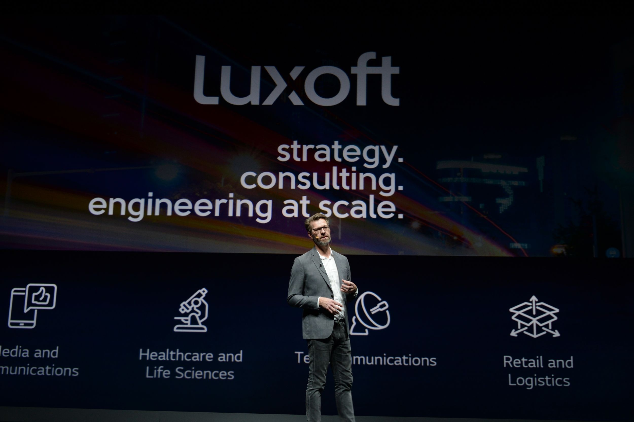 Mr. Alwin Bakkenes, managing director of automotive at Luxoft, delivers the keynote address.