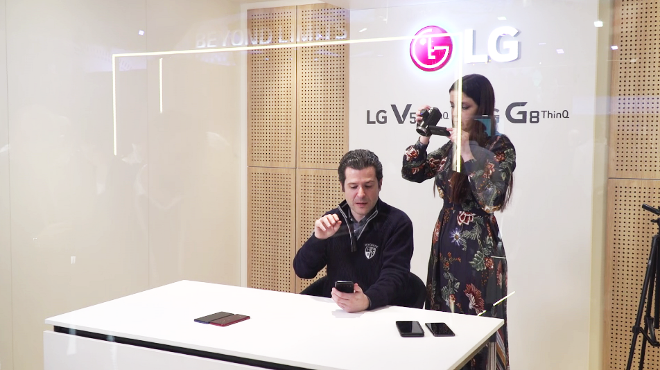 A male journalist shoots a hands-on video for LG's V50 ThinQ smartphone in the LG Creator's Studio.