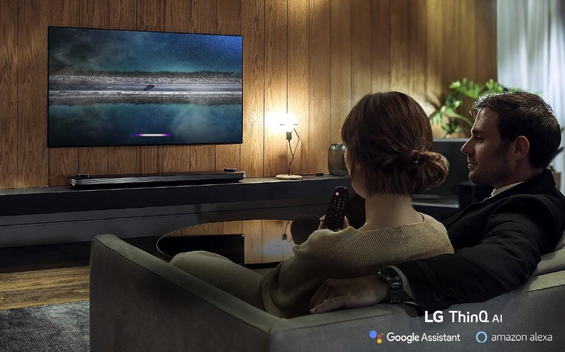 A couple watching their LG ThinQ AI TV