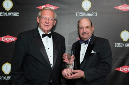 John Taylor, Senior Vice President of Public Affairs for LG USA receives the trophy from the representative of 2019 Gold Edison Award.