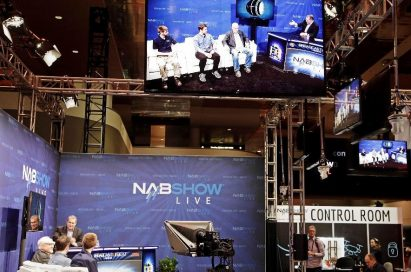 LG's 55-inch OLED display is hung up above the venue of 2019 NAB Show to play a set of the NABShow Live video content.