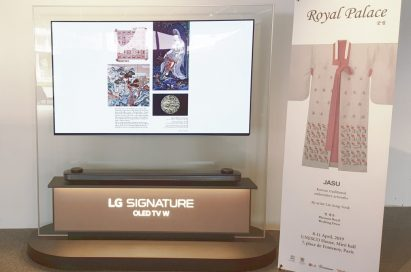 """The LG SIGNATURE OLED TV W and promotional banner introduce Korea's traditional """"chasu"""" embroidery."""