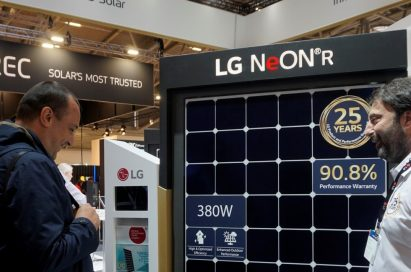 A male attendant explains the main features of LG NeON R high performance solar panel to a visitor.