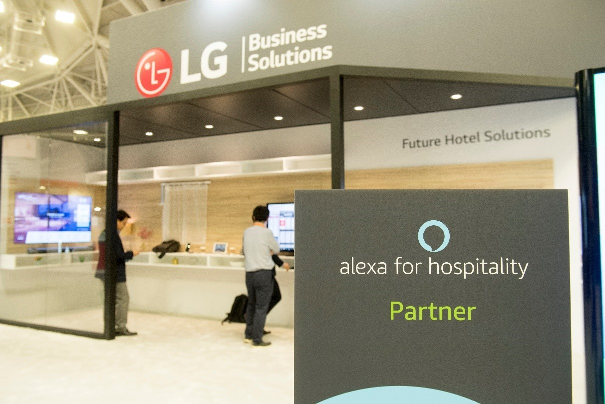 "The outside of LG's booth at the Hospitality Industry Technology Exposition and Conference, with a sign saying LG is an ""Alexa for Hospitality Partner."""
