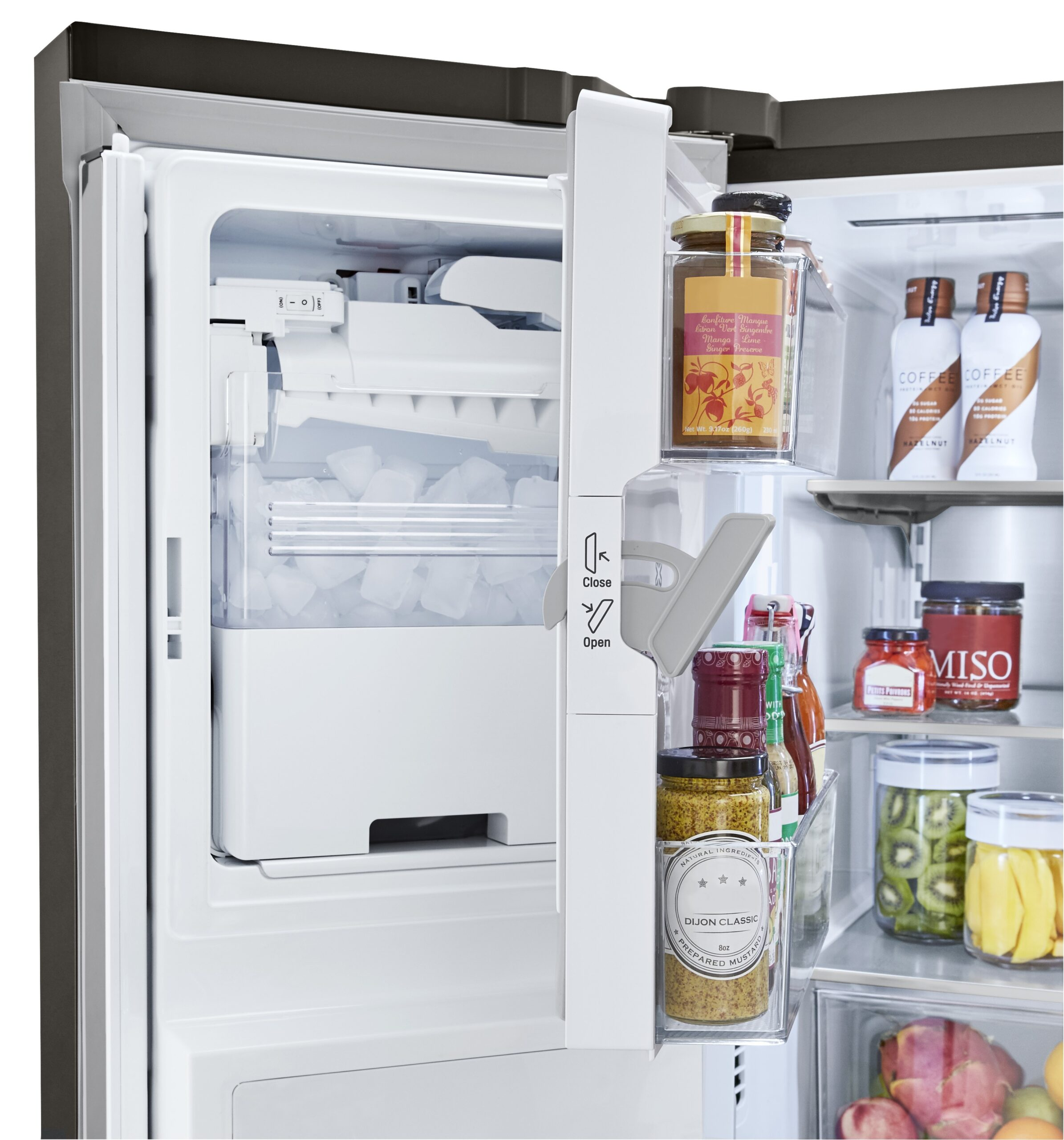 LG refrigerator partially opened to show the interior of its door-ice maker.