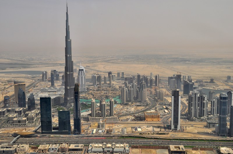 An upper view of Dubai with many buildings including Burj Khalifa, the world's tallest tower