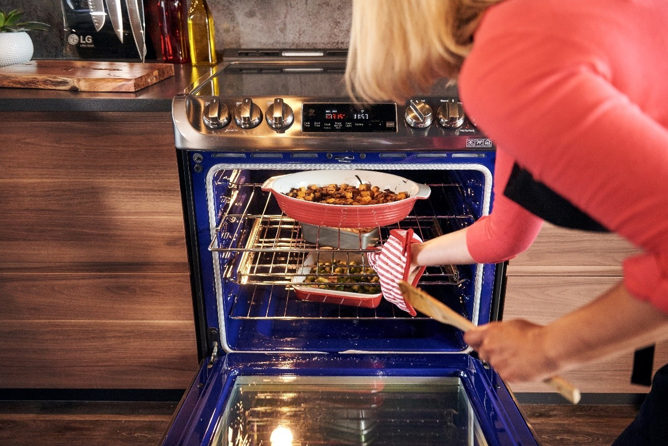 A lady takes out a casserole dish from the LG ProBake Convection® oven at the LG Kitchen Memory Rescue event.