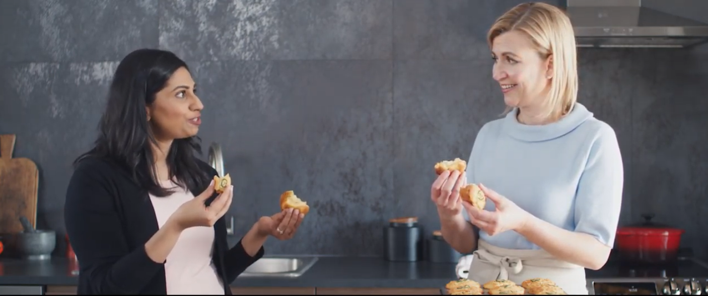 Two ladies stand next to each other and discuss the food they cooked using the LG ProBake Convection® oven.