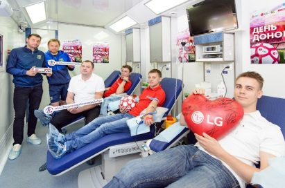Another group photo of FC Lokomotiv Moscow's blood donors, some of football players lie on the cots to donate their blood.