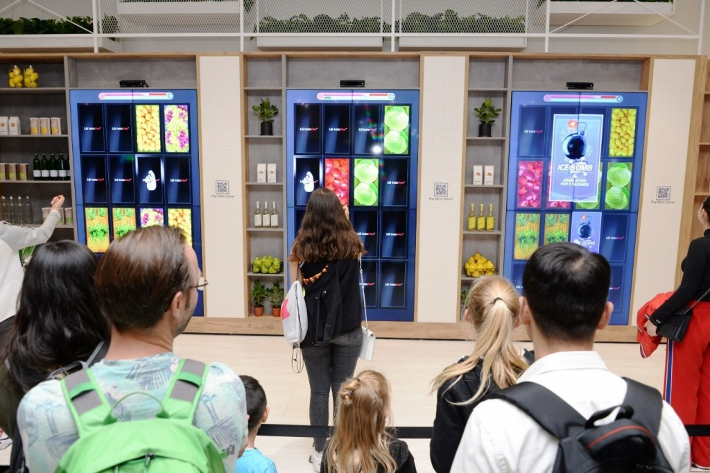 Visitors play the Knock Knock Market card matching game at the LG InstaView Door-in-Door refrigerator highlight zone.