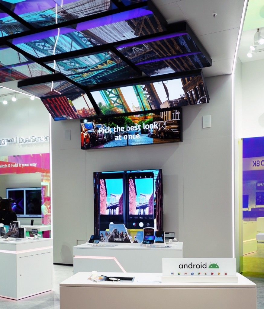 The LG G8X ThinQ zone is viewed from the other direction and the zone demonstrates the key features of LG G8X ThinQ using a number of large TV displays.