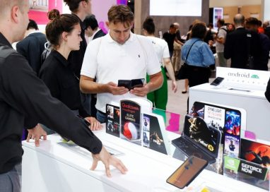 A visitor to LG MC booth looks down at the screen of the LG G8X ThinQ Dual Screen.