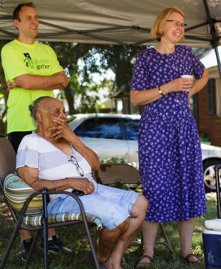 A view of volunteers and a resident of Charlotte's Druid Hills neighborhood who smile during the event
