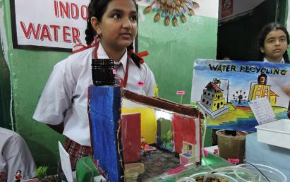 Two girl students give their presentations about the water conservation and the importance of safe drinking water.
