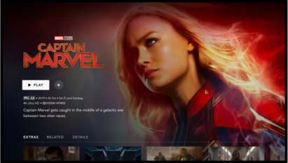 The Disney+ app on a television displays the content information and play button for superhero movie Captain Marvel.