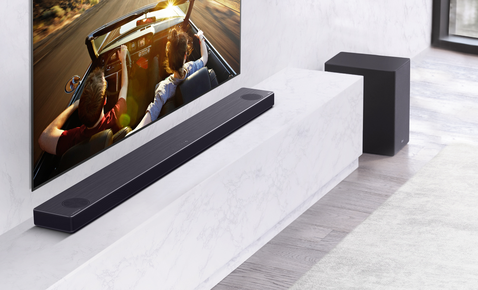 LG Soundbar model SN11RG installed on a shelf under an LG TV as it delivers truly dynamic sounds