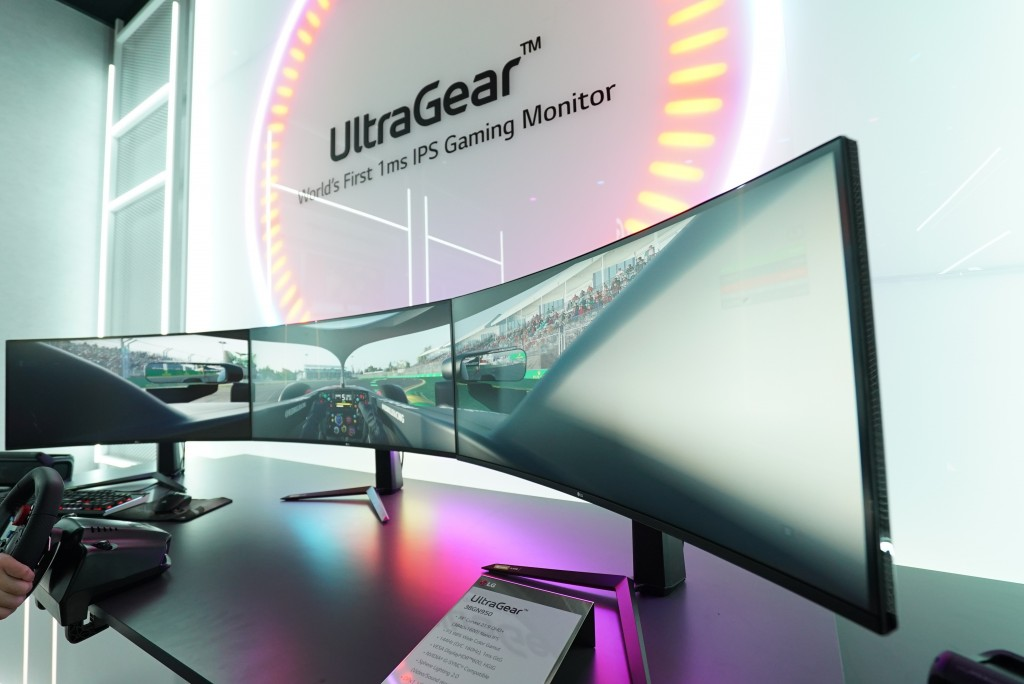 A closer look at three UltraGear monitors being used side-by-side to create one ultra-wide display to play a racing game at LG's CES 2020 booth