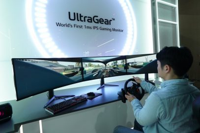 A man uses three wide LG UltraGear monitors side-by-side to experience an immersive racing game setup at CES 2020 with record-breaking 1ms response rates