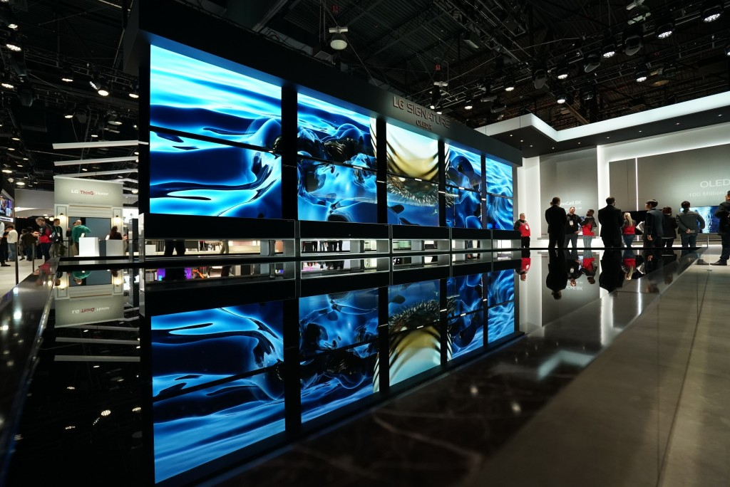 Ten LG SIGNATURE OLED R TVs, five hanging upside down, create an awe-inspiring display at the company's CES 2020 booth