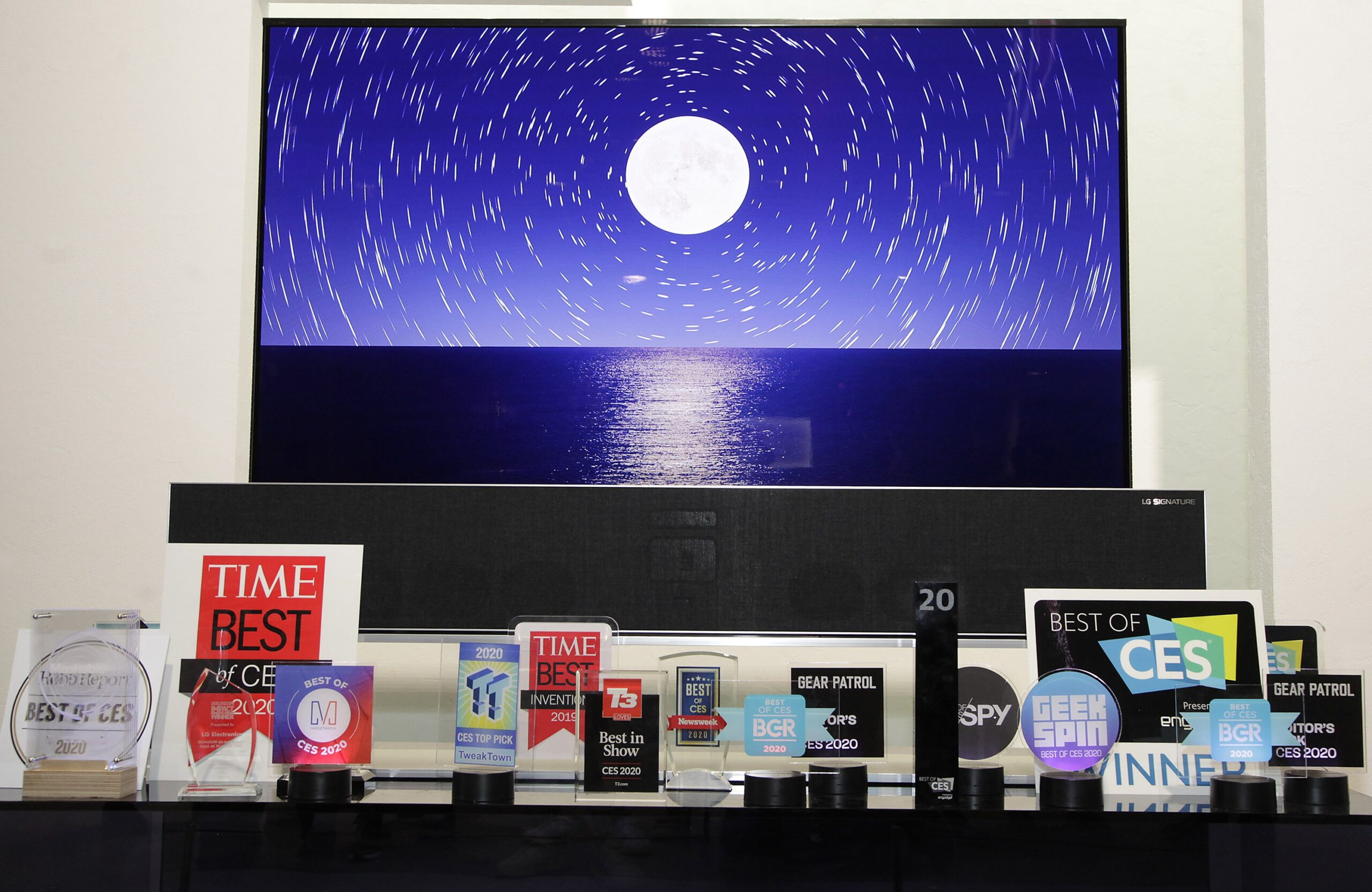 The LG SIGNATURE OLED TV R displayed behind numerous awards LG Electronics (LG) won during a record-breaking CES for the company