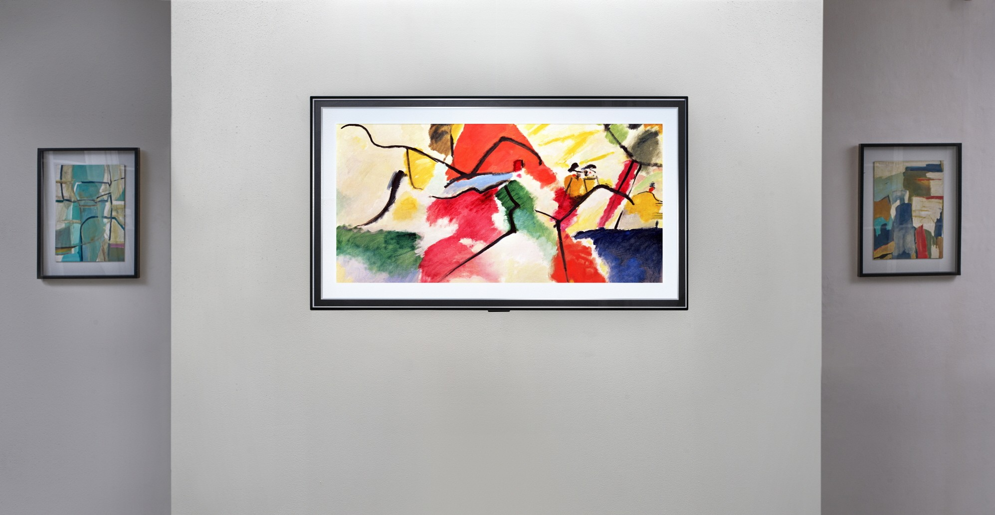 Front view of LG Gallery series model GX hanging flush on the wall of an art exhibition as it blends effortlessly in between other pieces on display