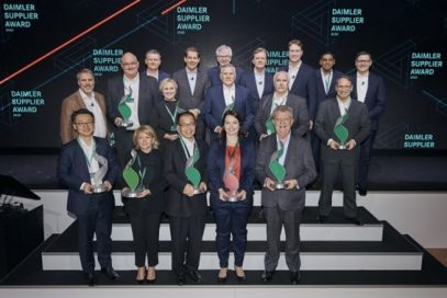 Winners of a Daimler Supplier Award pose with their trophies on the main stage