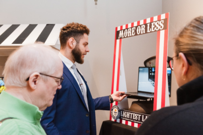 A man weighs the LG gram on the scale placed inside its 'More or Less' display
