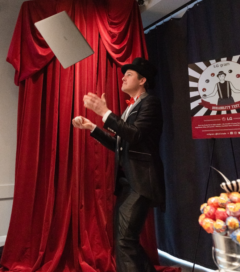 An entertainer uses LG gram in his juggling routine while on stage at an LG event