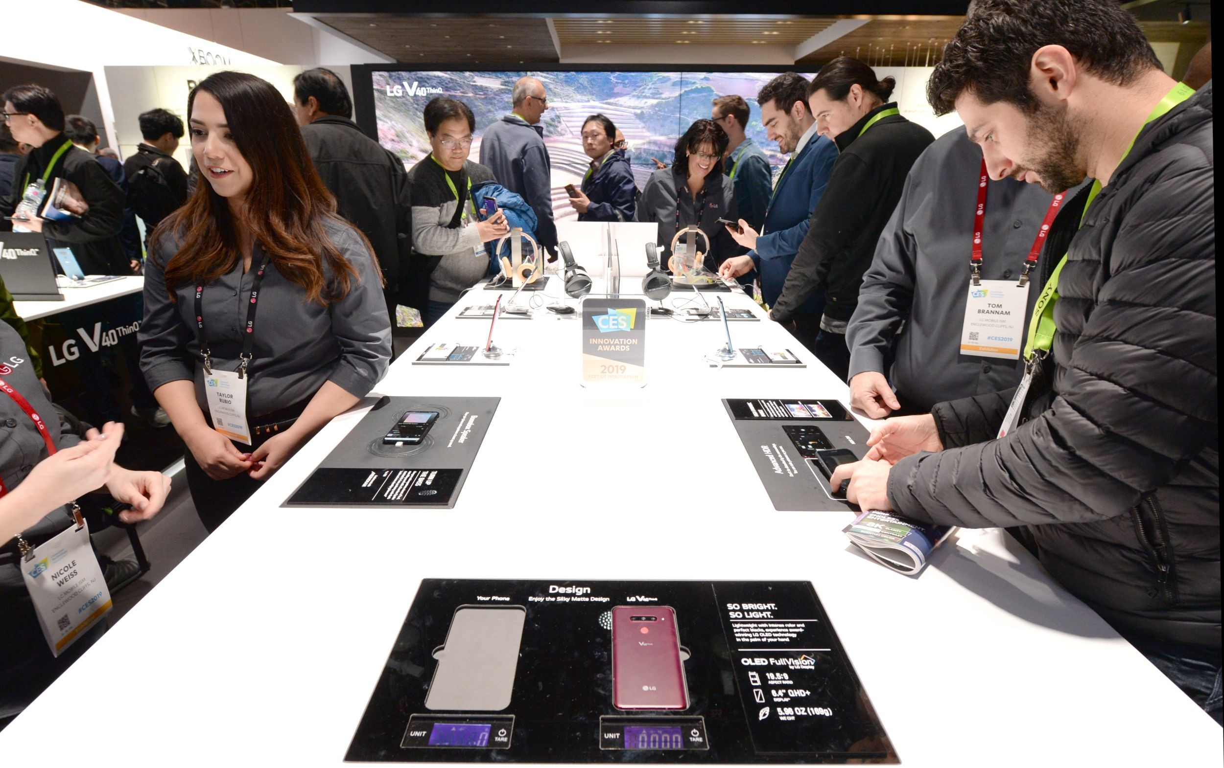 Numerous CES attendees test out the new features of LG's smartphones including LG V40 ThinQ