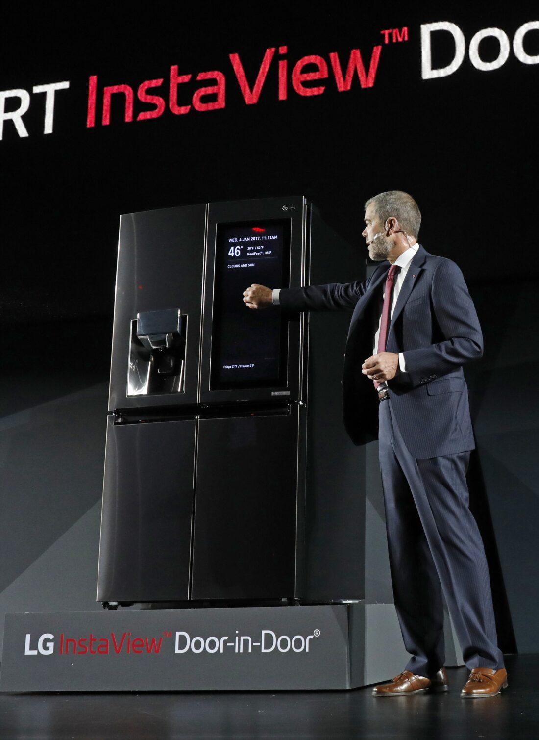 David VanderWaal, Senior Vice President, Marketing, LG Electronics demonstrates the InstaView feature of LG's InstaView Door-in-Door refrigerator at its CES 2017 Press Conference.