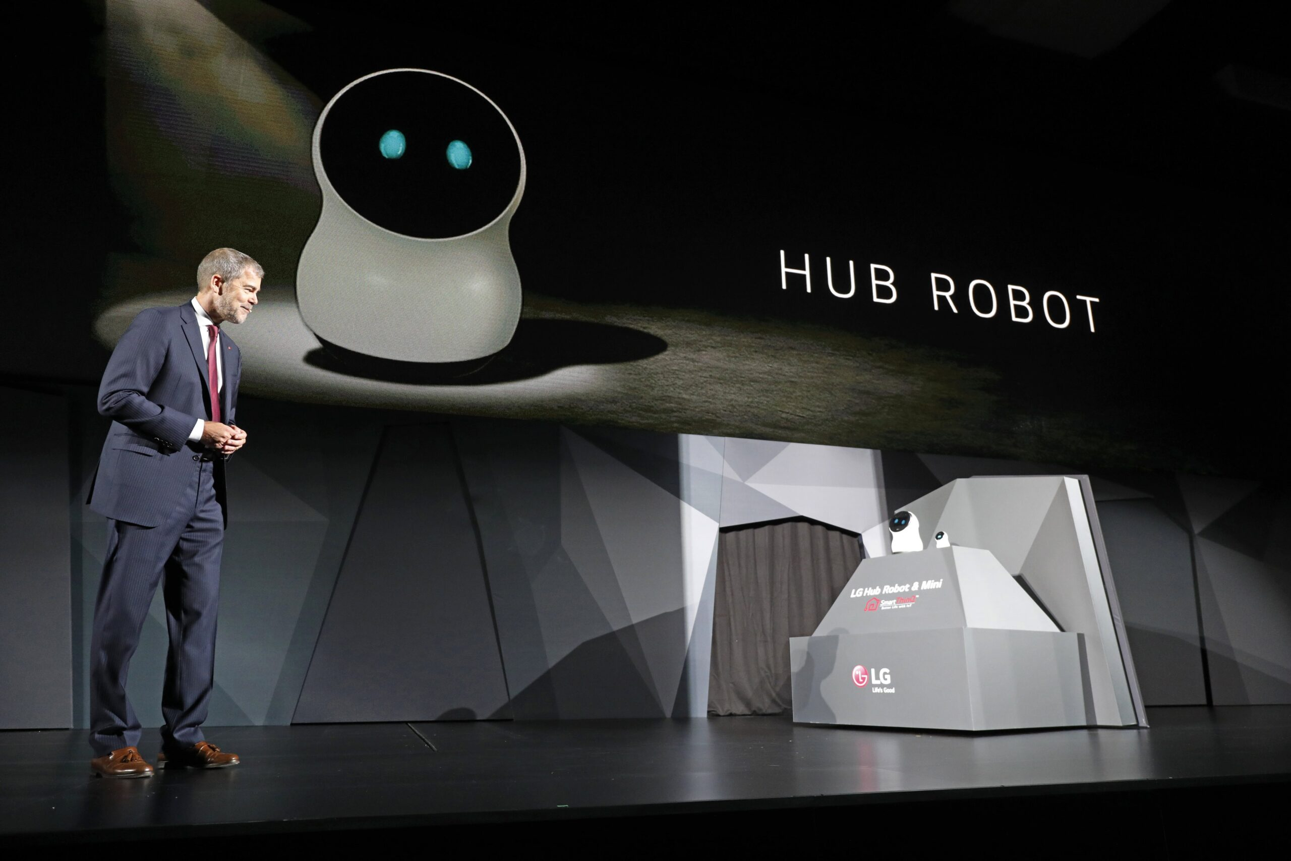 David VanderWaal, Senior Vice President, Marketing, LG Electronics interacts with LG's CLOi Hub Robot at its CES 2017 Press Conference.