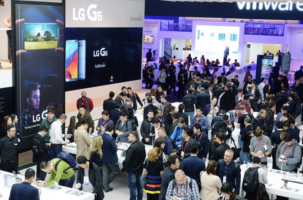 Conference attendees walk around and test out the products at the LG's MWC 2017 booth.