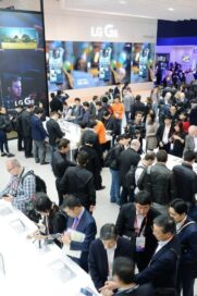 Closer view of conference attendees walking around and testing out the smartphones at LG's MWC 2017 booth