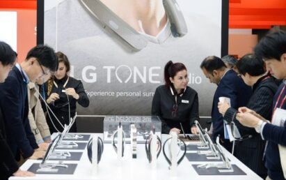 Close view of visitors testing out the LG TONE Flex Premium Bluetooth headsets at the LG TONE Studio zone at MWC 2017