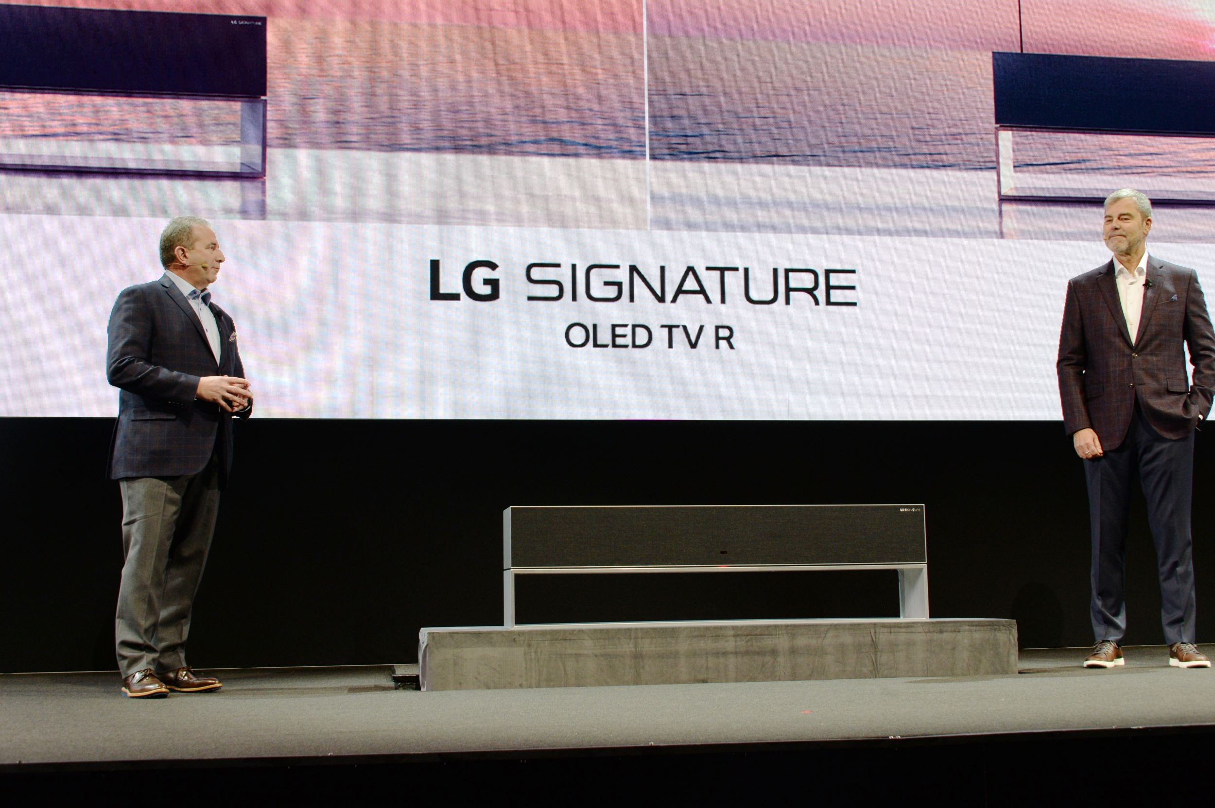 David VanderWall, Senior Vice President of Marketing at LG Electronics USA and Tim Alessi Senior Director of Product Marketing for Home Entertainment Products at LG Electronics USA introduce the LG SIGNATURE OLED TV R at LG's CES 2019 Press Conference while putting the TV between them.