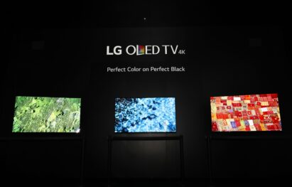 Three LG OLED TV models demonstrate the perfect colors and perfect black in a dark room at LG's CES 2017 booth.