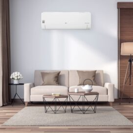 A peaceful living room with an LG air conditioner fitted above the sofa