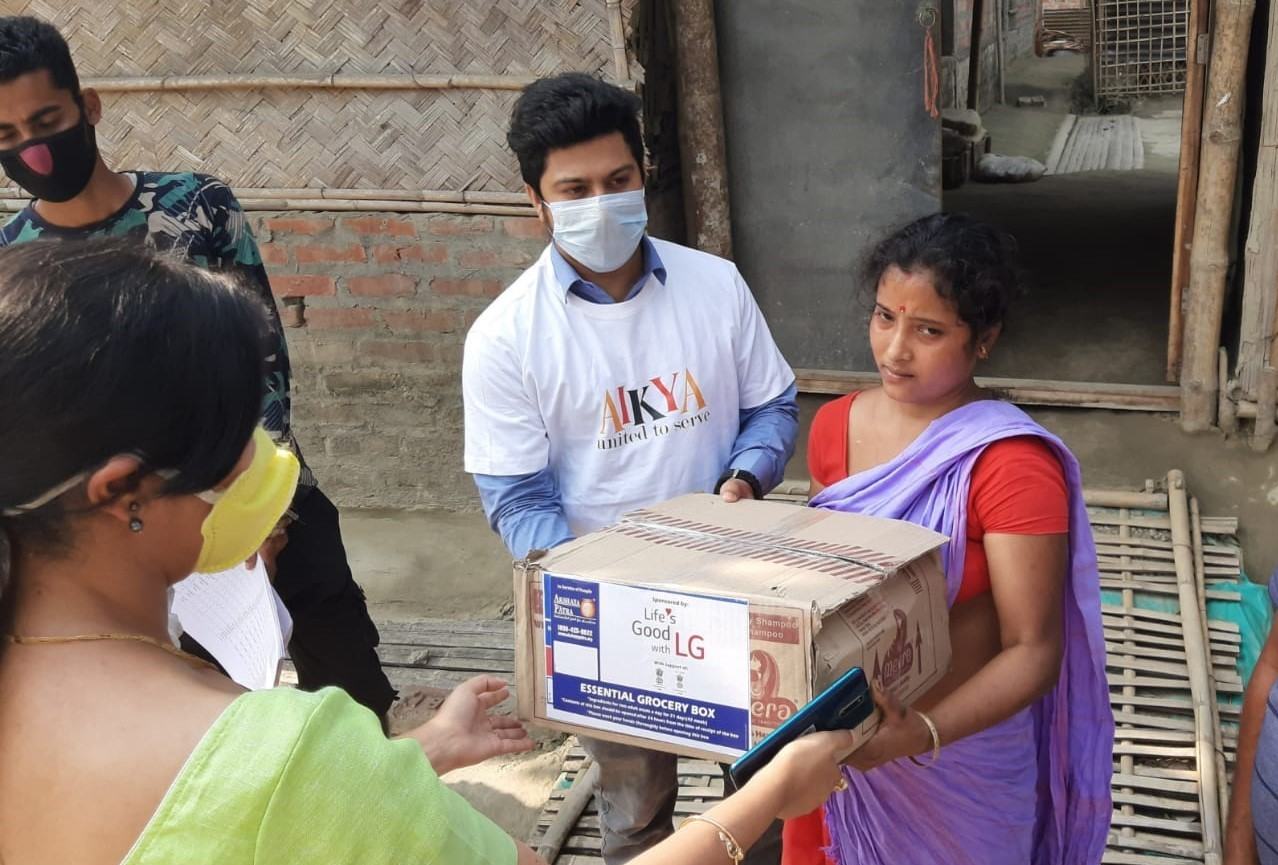 A man and woman in India gifting LG products to others