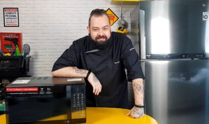 Filipe Nascimento poses with the LG EasyClean microwave oven