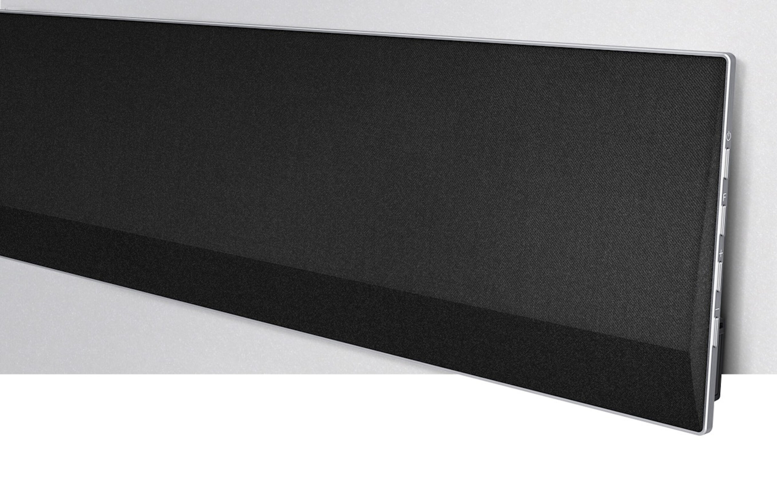 Side view of one end of LG's GX Soundbar against a wall, providing a closer look of its sturdy steel stand