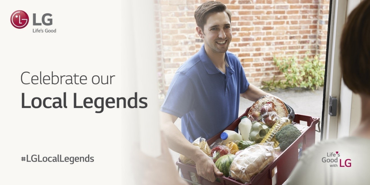 """A man carries groceries into someone's house with the tagline, """"Celebrate our Local Legends', displayed on the left"""