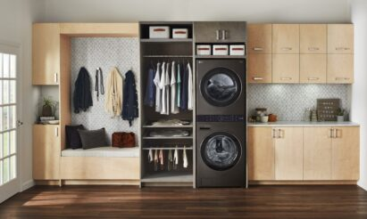 The black LG WashTower fitted inside a modern room with wooden furnishings and next to a space designed to store your clean clothes after washing